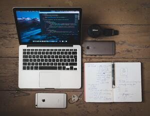 computer and notepad for website